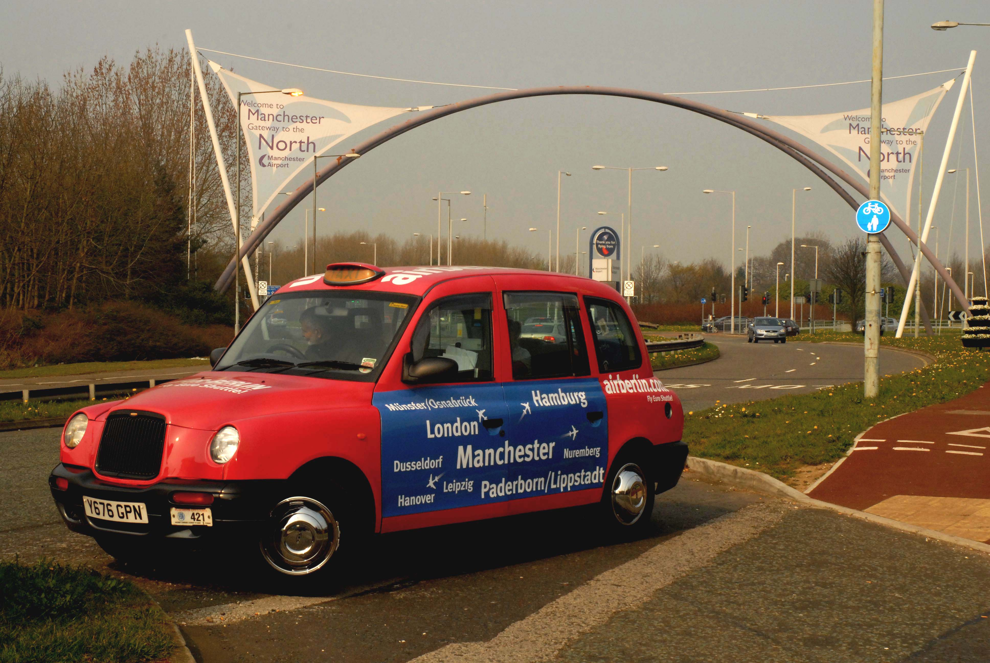 2007 Ubiquitous taxi advertising campaign for Manchester Airport - Air Berlin.com - London - Manchester