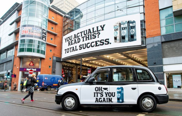 Oatly SuperSide taxi and poster