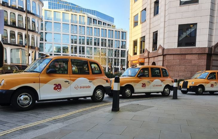 Convoy of Avanade wrapped taxis
