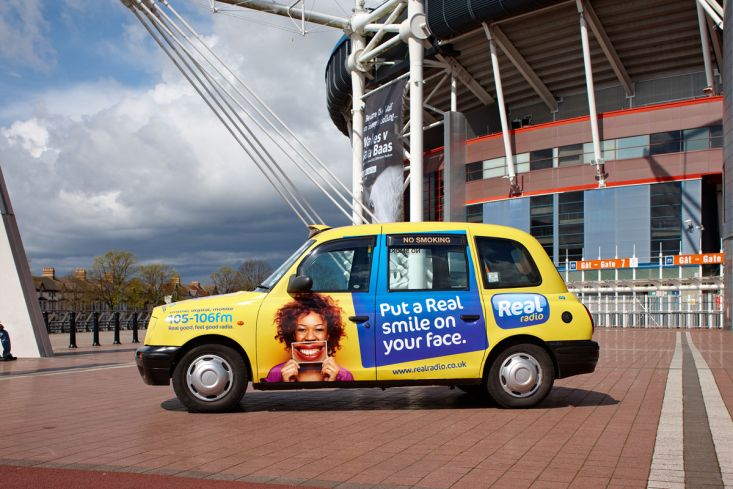 2012 Ubiquitous taxi advertising campaign for Real Radio - Put a Real Smile on your Face